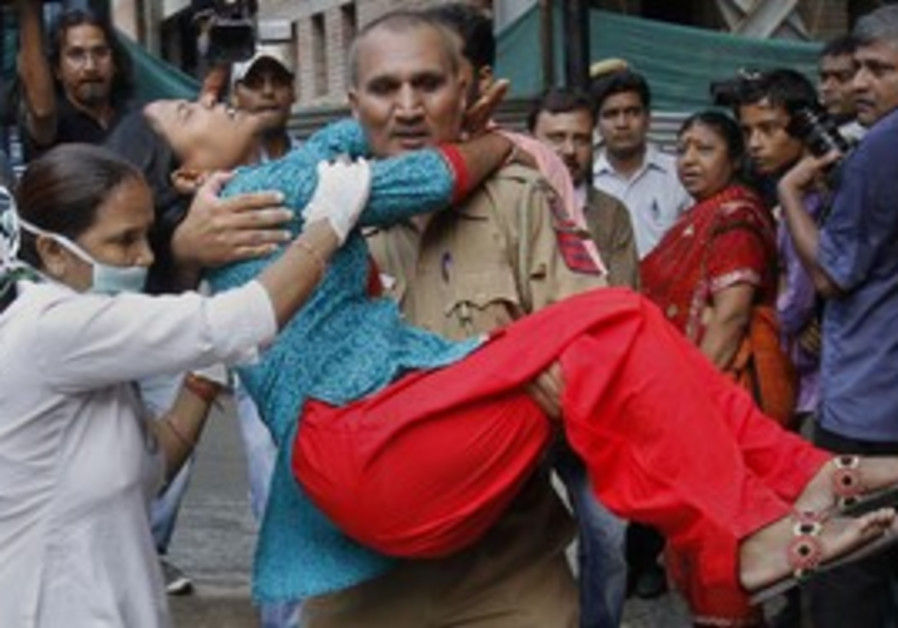 nurse carries woman from New Dehli attack