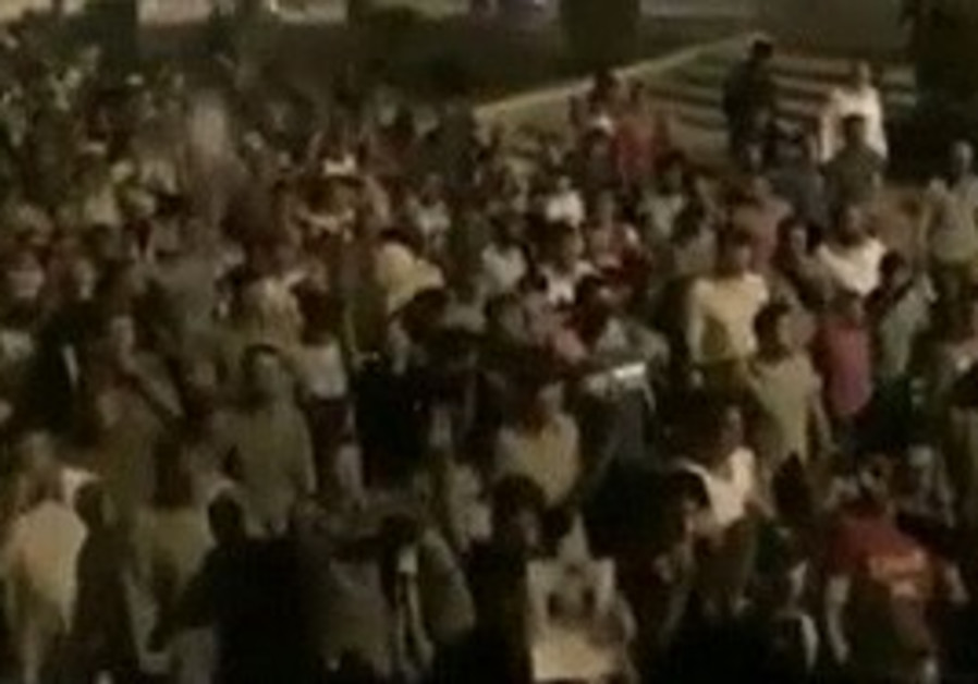 Syrian demonstrators at night protest