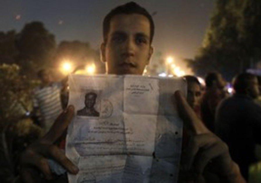 Egyptian protester holds documents from the Israel