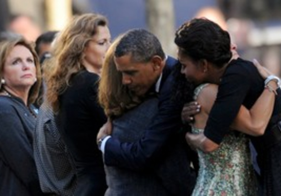 President, First Lady hug families of 9/11 victims