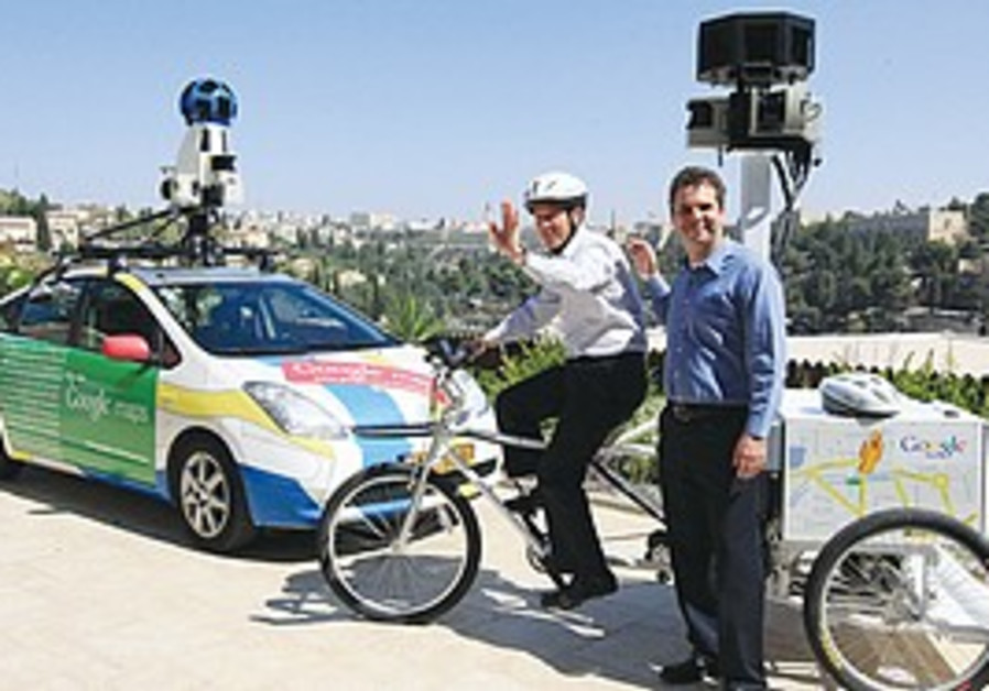 Nir Barkat rides the Google tricycle.
