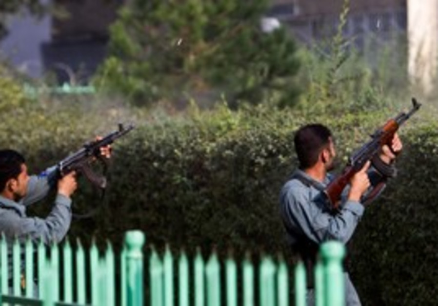Afghan policemen fire toward  building