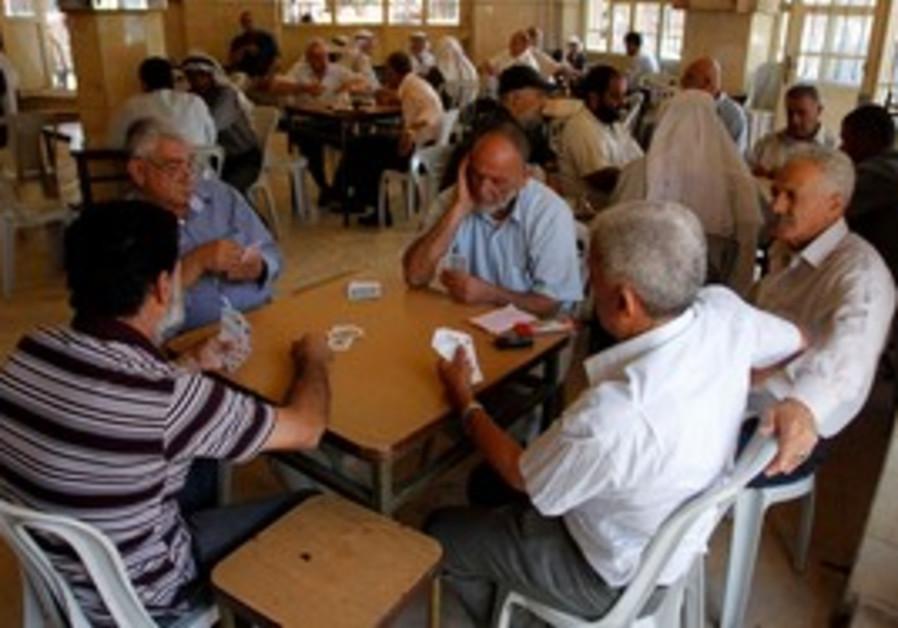 Palestinians playing cards in Ramallah cafe
