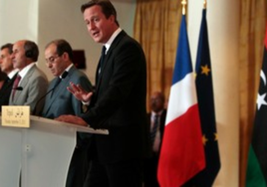 Cameron speaks at news conference in Tripoli