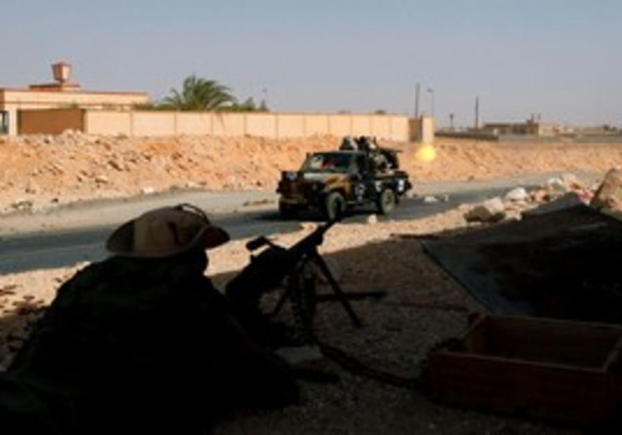 Anti-Gaddafi forces assault Bani Walid stronghold