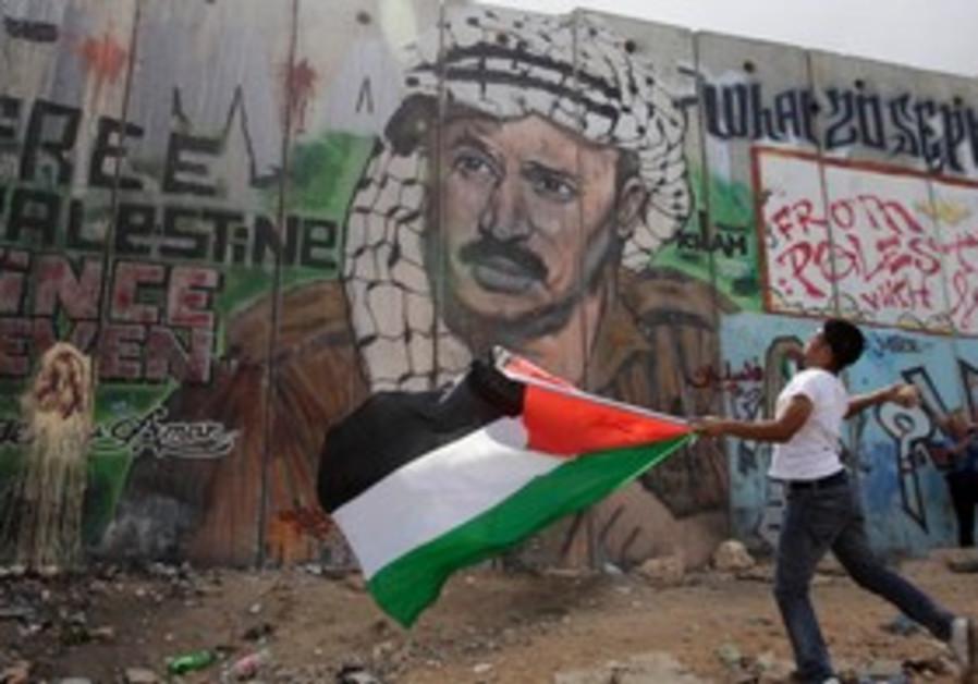 Palestinian youth throws stones at Kalandia