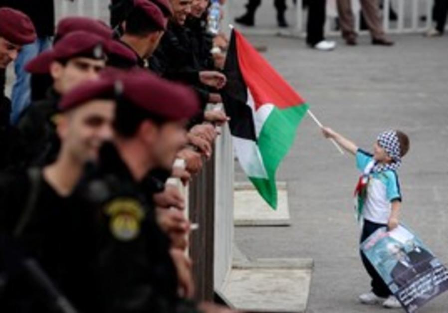 Palestinian boy at rally for Abbas in Ramallah
