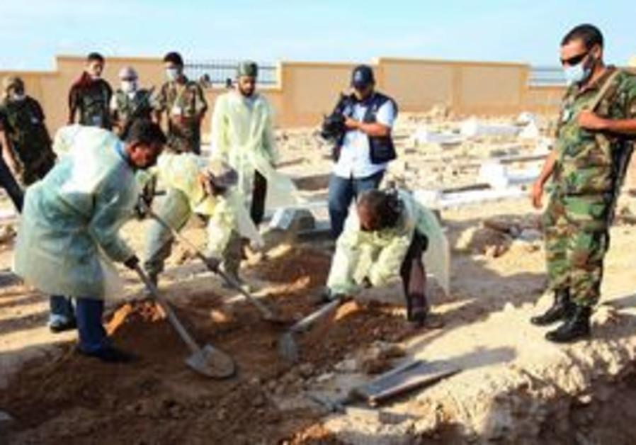 Medical, militia officials dig bodies in Tripoli