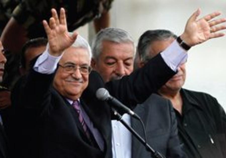 PA President Mahmoud Abbas waiving