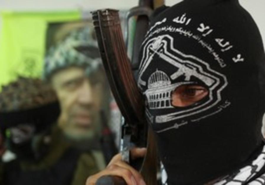 Masked member of Fatah military wing [file]
