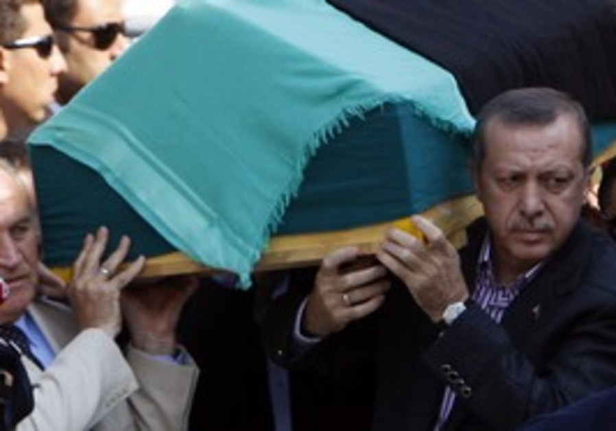 Erdogan carries his mother's coffin at funeral