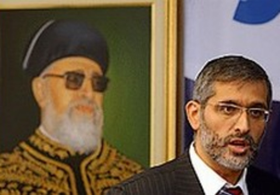 eli yishai with ovadia picture behind him