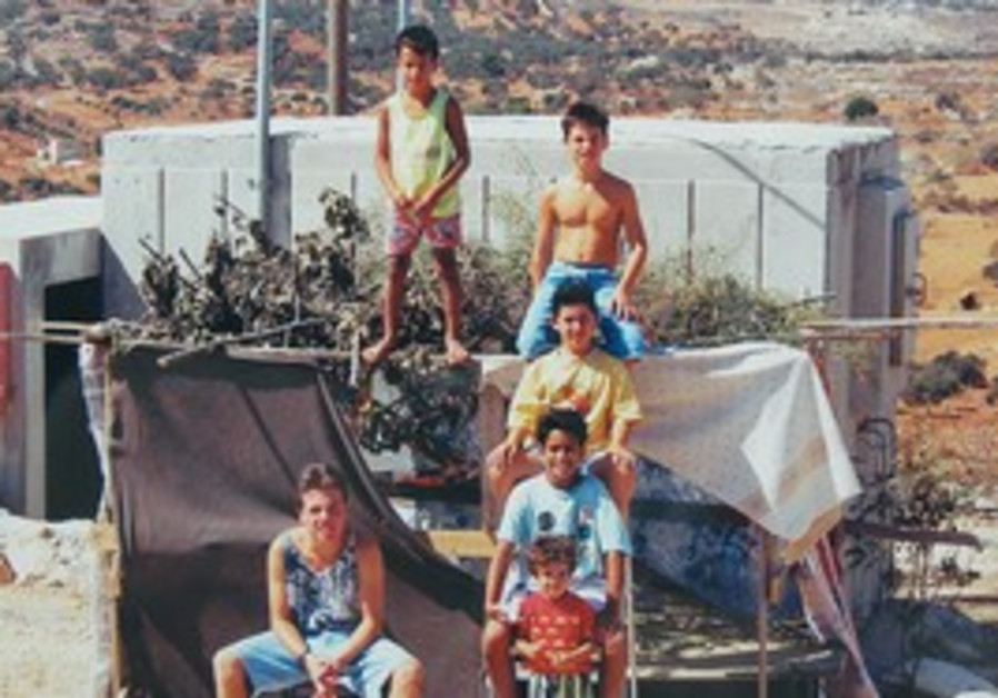 Youth standing next to their Succa, Samaria 1990