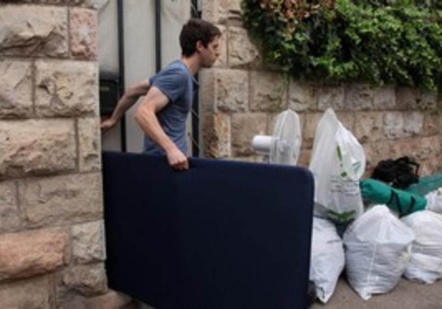 Yoel Schalit helps pack ahead of departure