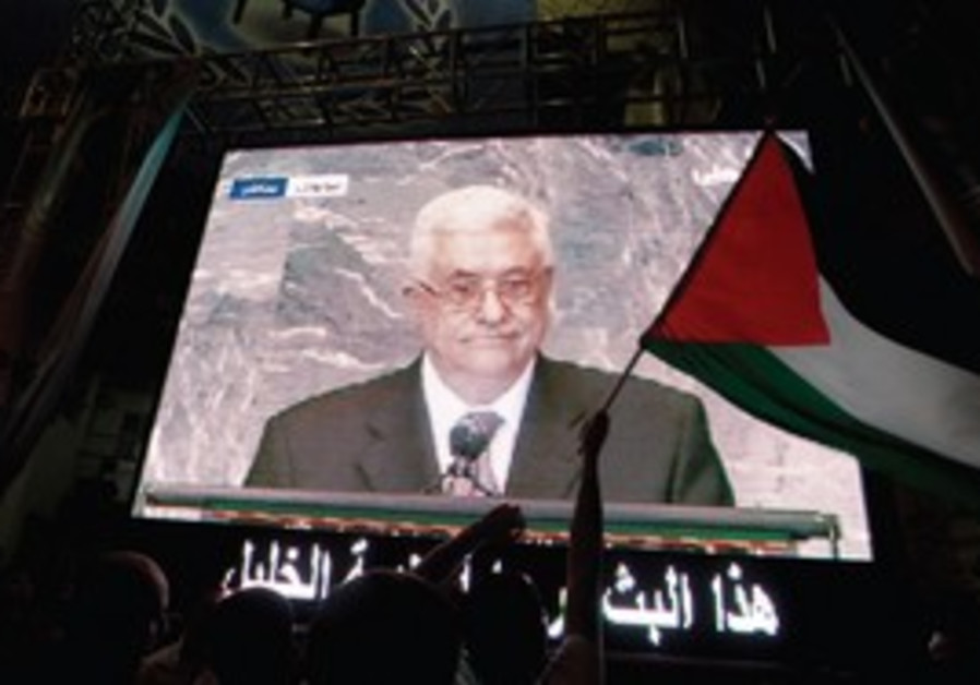Palestinians in Hebron watch PA President Abbas.