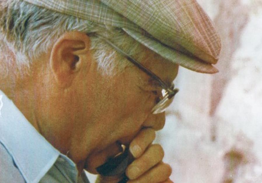 Old man prays at Western Wall.