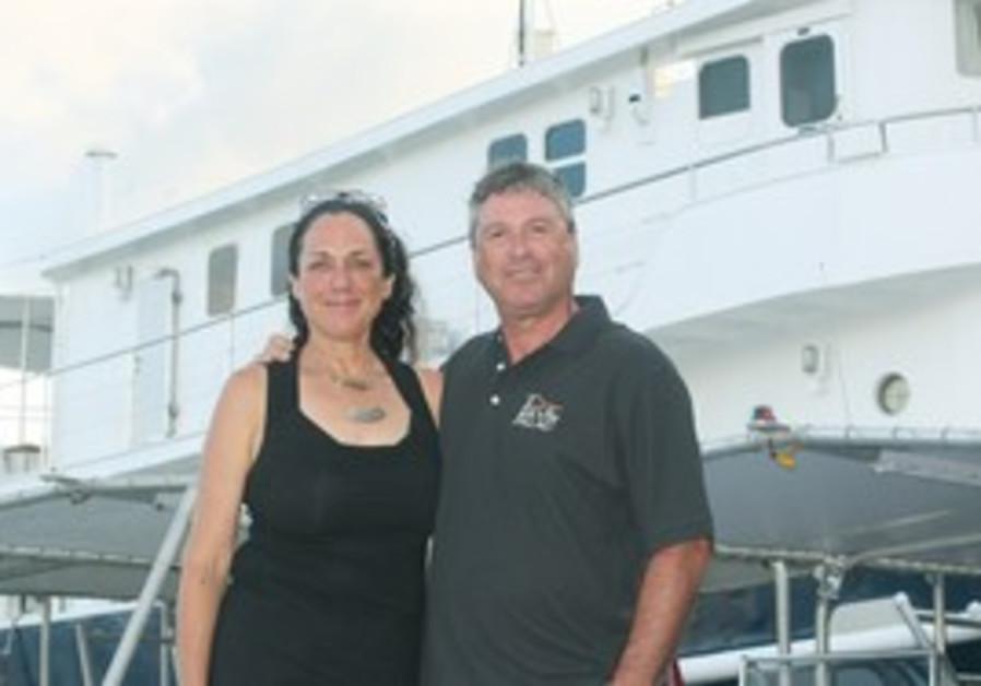 Tova and Navot Bornovski in front of Ocean Hunter