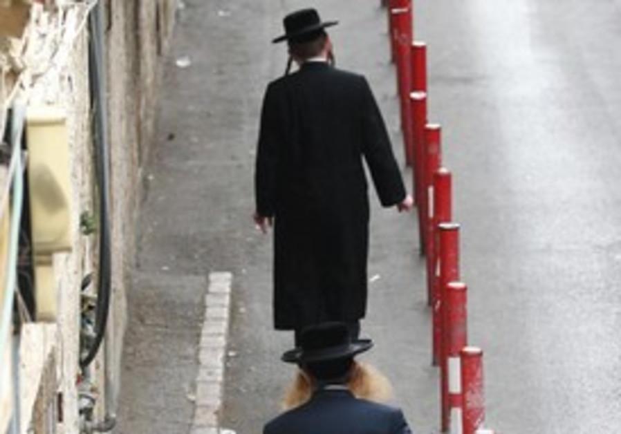 Haredi man walks down street in Mea She'arim.