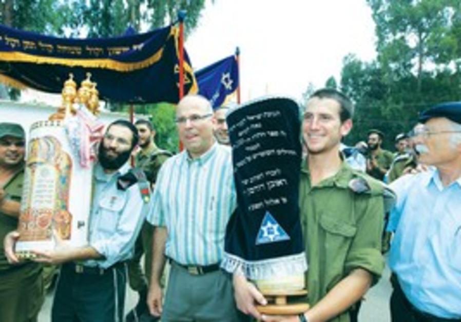 A soldier celebrates Torah dedication