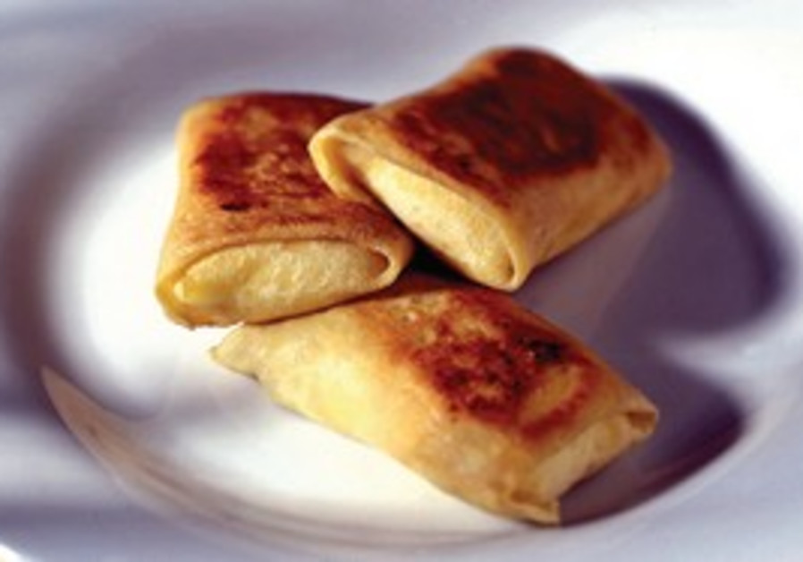 Apple blintzes with walnuts and wine