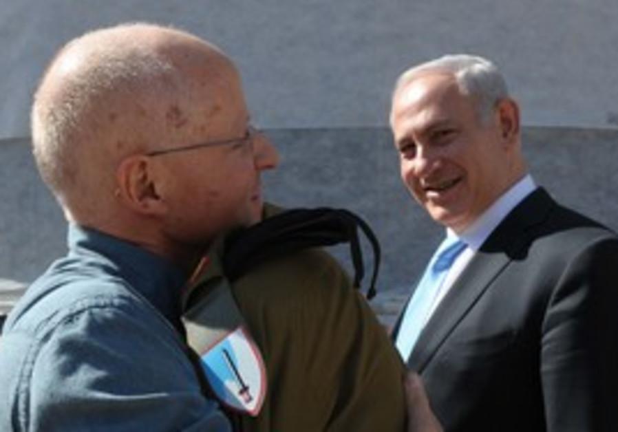 Gilad Schalit hugs father Noam
