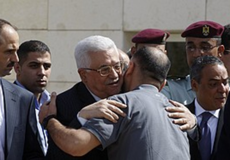 Abbas greets a newly released prisoner [file]