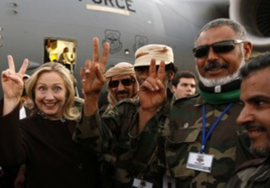 Clinton in Tripoli with NTC forces
