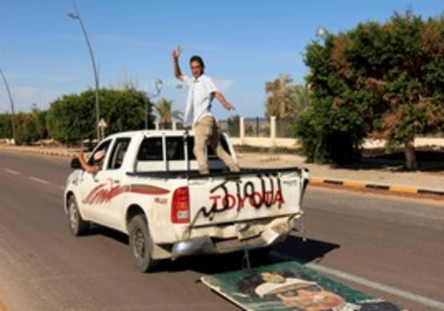 Anti-Gaddafi fighters after fall of Sirte