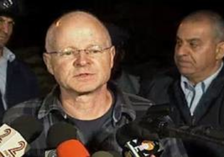 Noam Schalit speaks with reporters in Mitzpe Hila