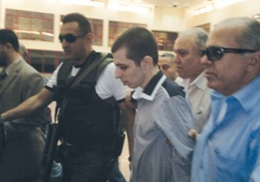 Hamas escorts Gilad Schalit out of captivity