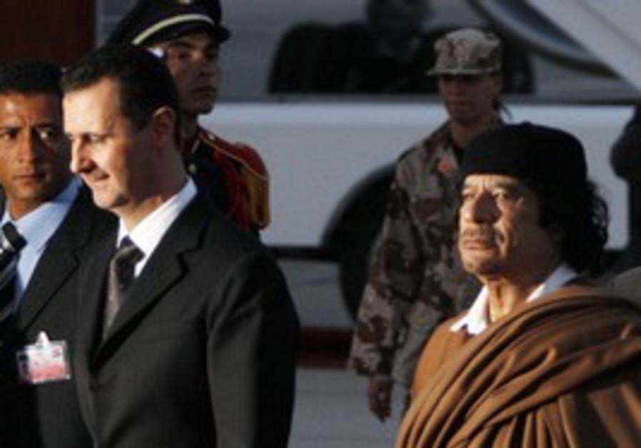 Syria's Bashar Assad with Muammar Gaddafi