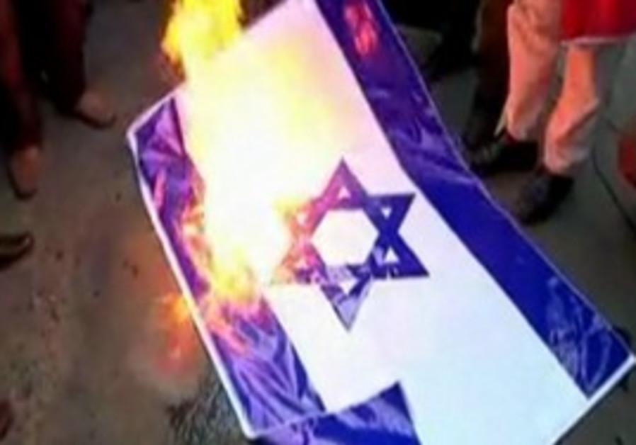 Burning Israeli flag at 'Occupy Tehran'