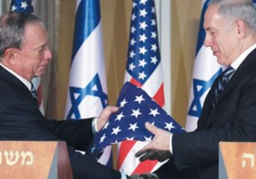 NY's Bloomberg hands an American flag to Netanyahu