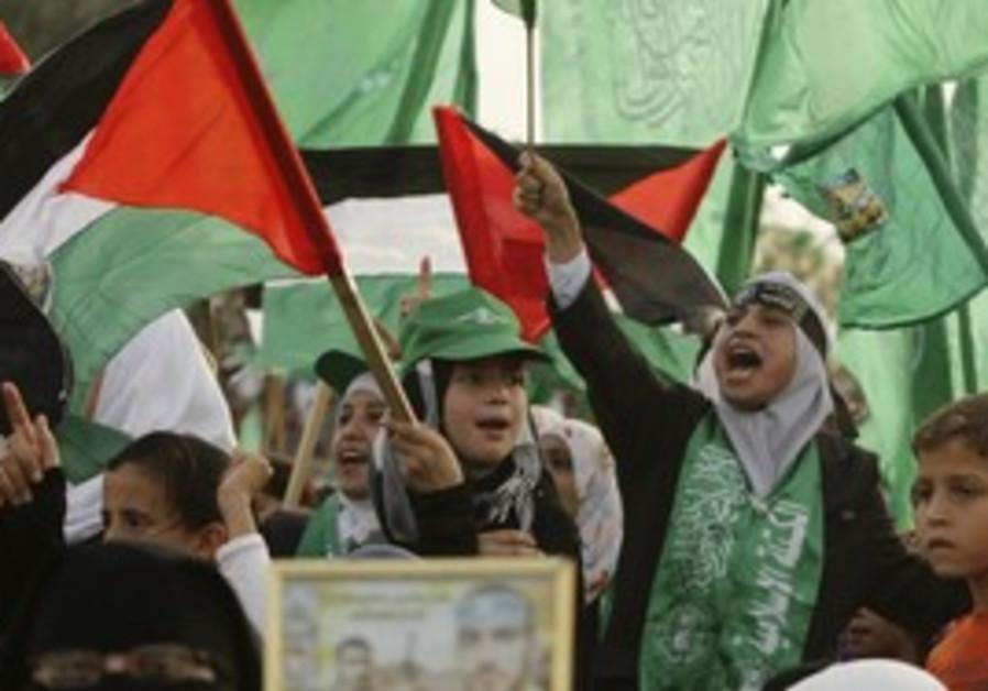 Children await the release of Hamas terrorists.