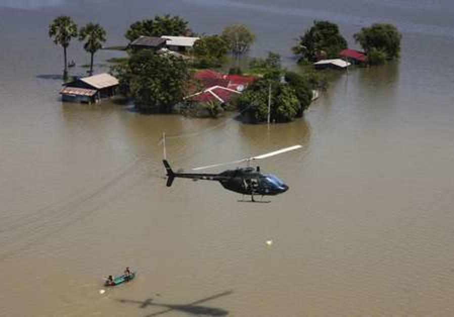 Thai army helicopter drops food to stranded people