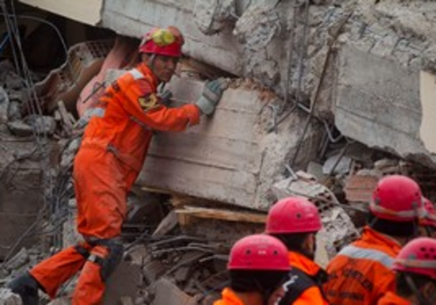 Rescue workers search earthquake rubble in Turkey