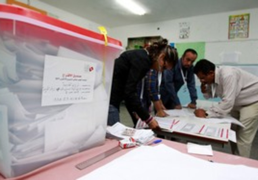 Election workers count ballots in Tunisia