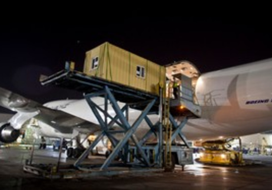 Prefabricated homes are loaded onto ElAl cargo jet