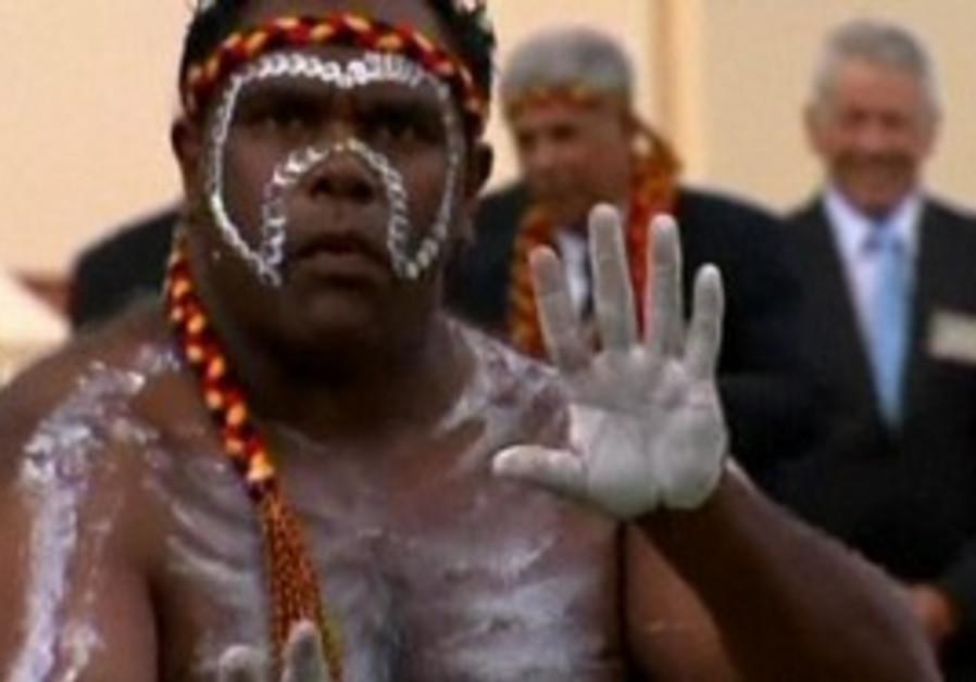 Aboriginese perform for Queen Elizabeth.