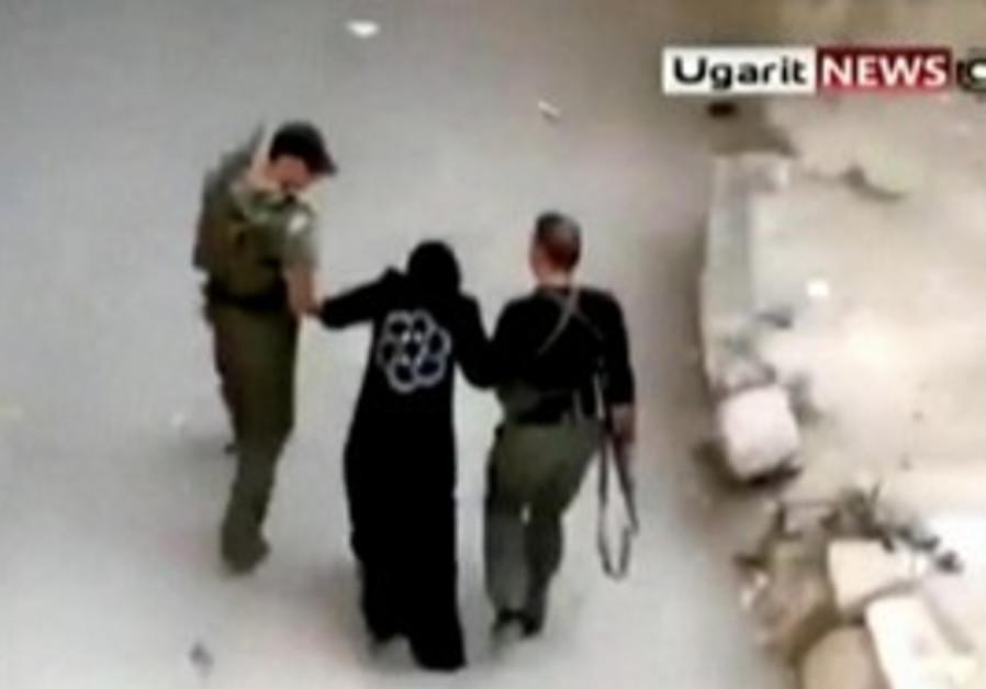 Syrian forces make arrests in Homs.