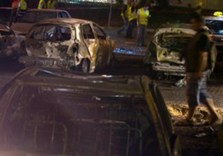 Burned out cars hit by Grad rockets in Ashdod