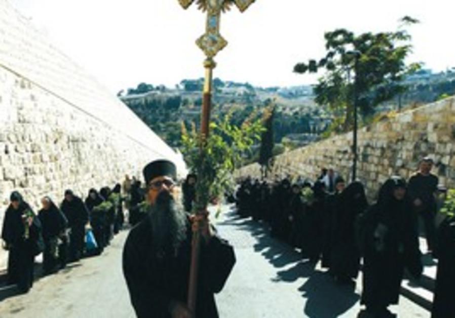 GREEK ORTHODOX clergyman leads a procession