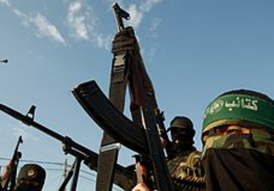 Hamas militants take part in a rally