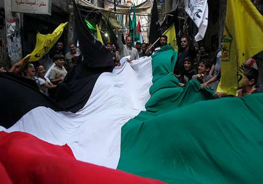 Palestinian supporters of the Hamas movement carry