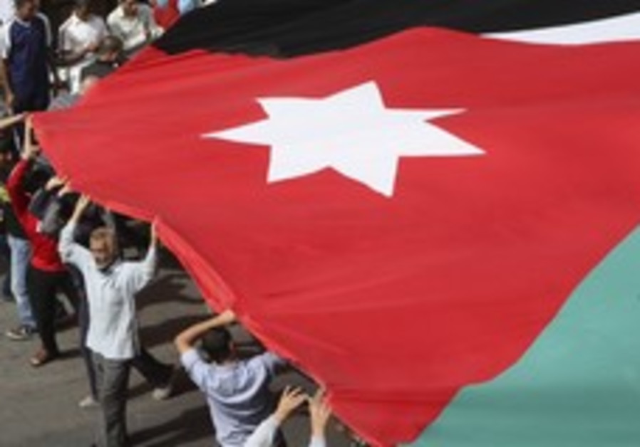 Protesters hold the Jordanian flag