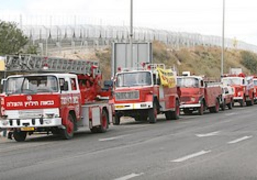 Fire trucks line up on Route 443 on Sunday morning