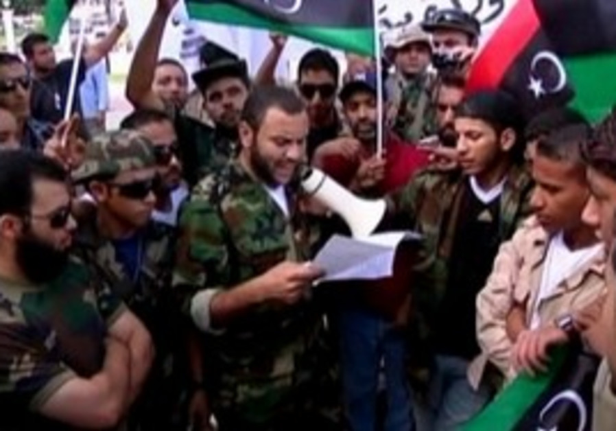 Libyan fighters demand pay