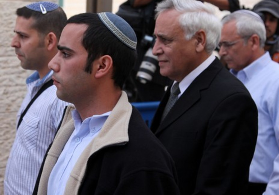Moshe Katsav leaves the Supreme Court after it upheld his rape conviction, Nov. 2011.