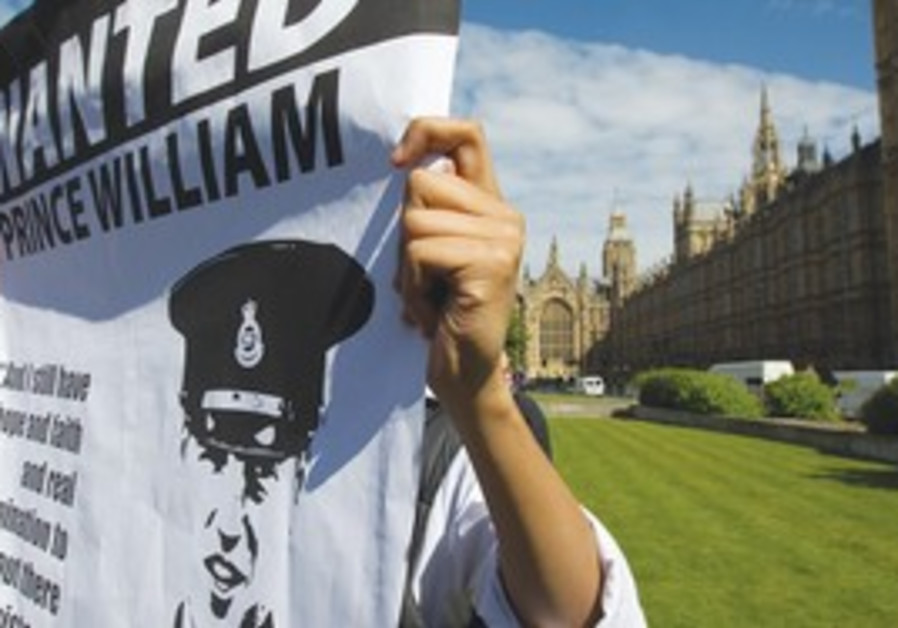 Member of Muslims Against Crusades holds poster