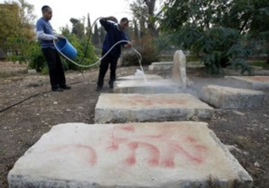 Workers clean price tag from Muslim cemetary, J'le